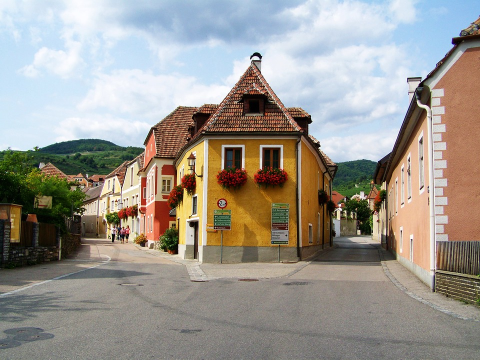 Image shows how a very gorgeous, small street in a small town looks like. Colorful and full of life.