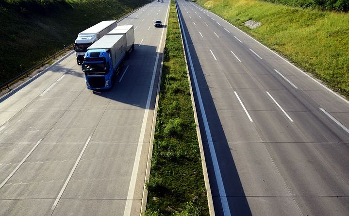 long distance movers trucks on the road