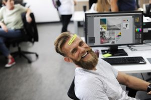 A man goofing off in his start-up - the best cities for entrepreneurs have a relaxed atmosphere.