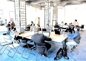 men and women in work space