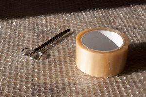 Bubble wrap, scissors, adhesive tape