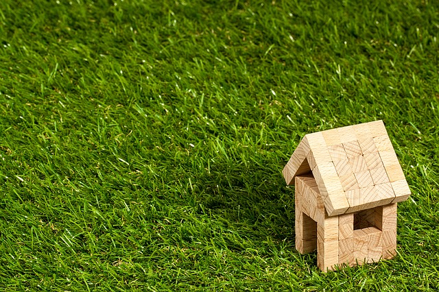 model of a house in grass, find out waht you need to know before investing in Florida real estate