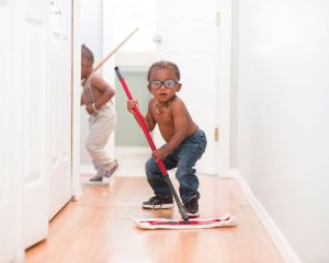 Two little boys with mops, showing you how to clean your apartment before moving out.
