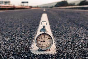 A clock on the road because not starting on time is one of the most common moving mistakes.