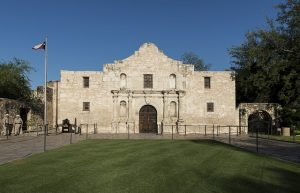 Alamo fort entrance in daytime you will have a cahance to see personally once you organize your move to San Antonio.