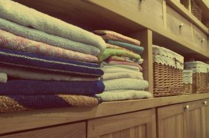 Folded clothes in a dresser before you pack clothes for moving.