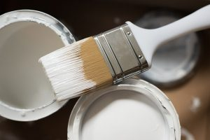 White paint and a brush.