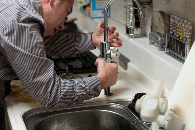 Fixing a plumbing, a potential part of household repairs after the move