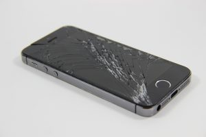 an iphone with a broken display