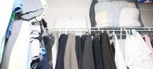 A closet containing clothes.