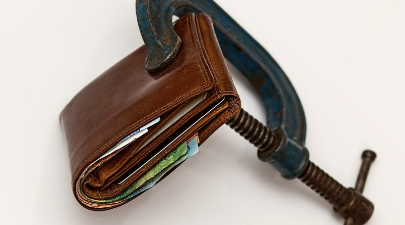A wallet squeezed tightly.