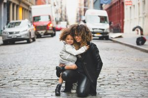 A mother and daughter on the street of one of the best cities in Upstate New York.