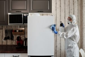 Person disinfecting a refrigerator