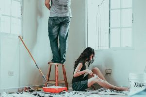 A couple painting the  house as you will do before moving to your dream house in Appolo Beach.