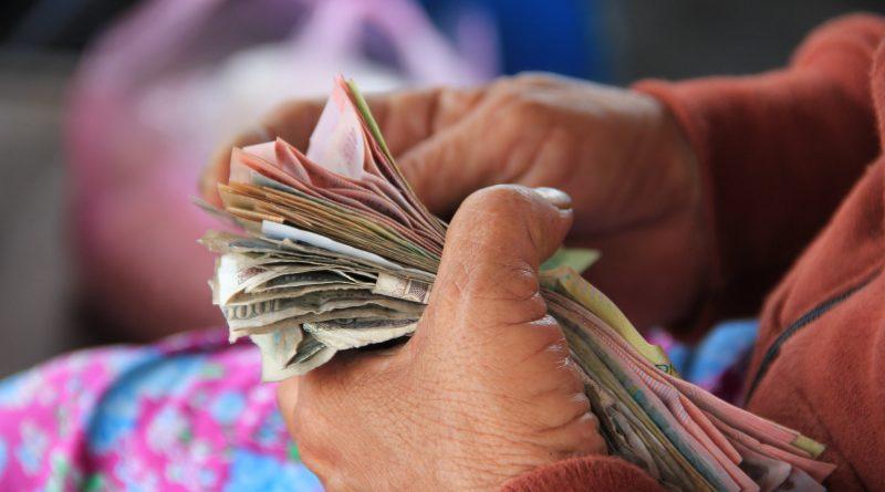 Money held in both hands.
