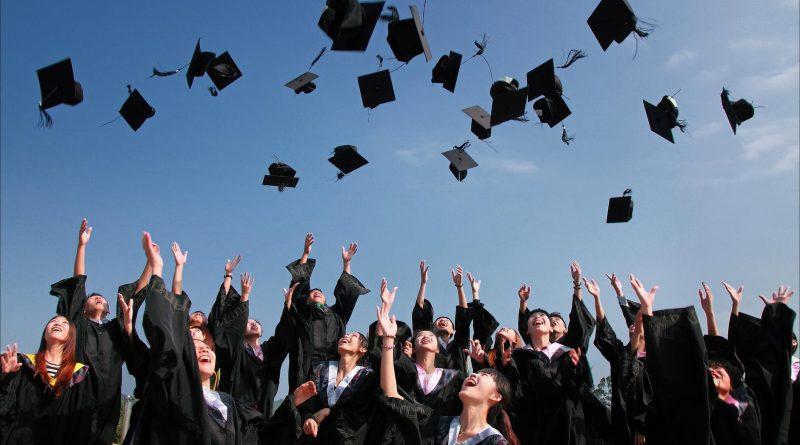 Graduates throwing their caps.