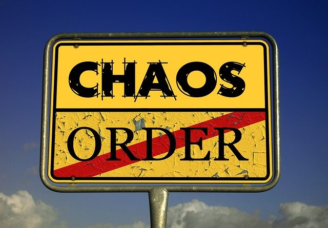 Street sign for chaos and order.