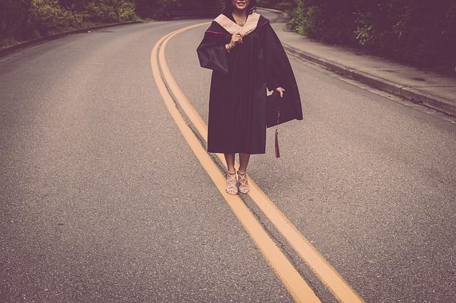 A girl walking down the road that symbolizes moving to Texas after college