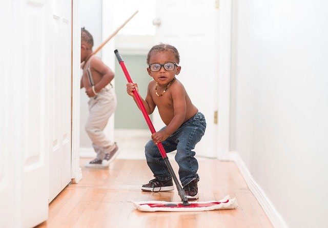 A child cleaning an apartment as your children can help you clean your apartment after moving in