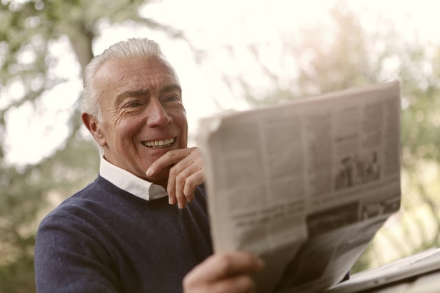 A senior man reading about why is Hampton, NH one of the finest locations for senior citizens.