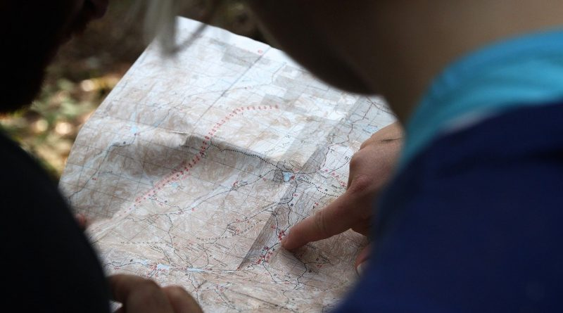 A man exploring a map and getting ready to explore Lino Lakes.