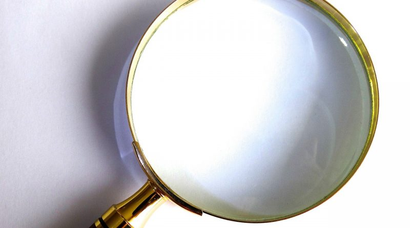 A magnifying glass symbolizing the difficulty to find perfect local movers in Elizabeth.