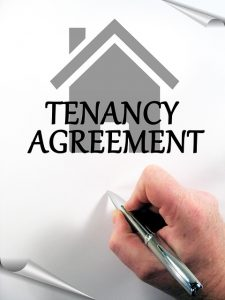 A man signing tenancy agreement.