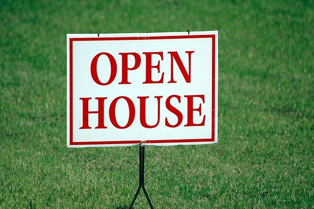 A sign for an open house.