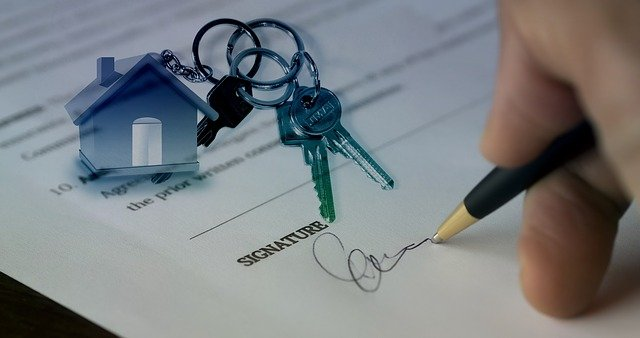Signing a contract for buying a new house