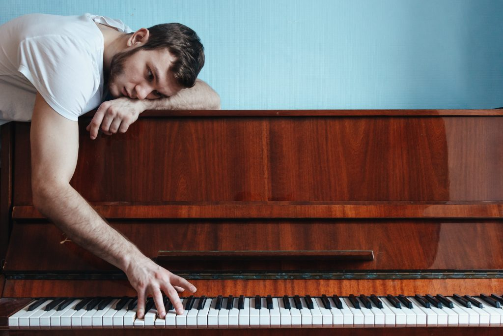a man playing a piano in one of Florida cities best for musicians