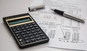 A calculator and financial paper to define the costs for buying a home in Ottawa real estate market.