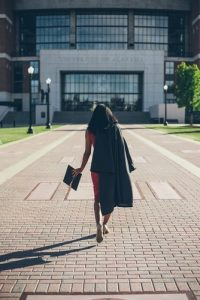 A college graduate walking on her way to meet one of small business owners for employment opportunities.