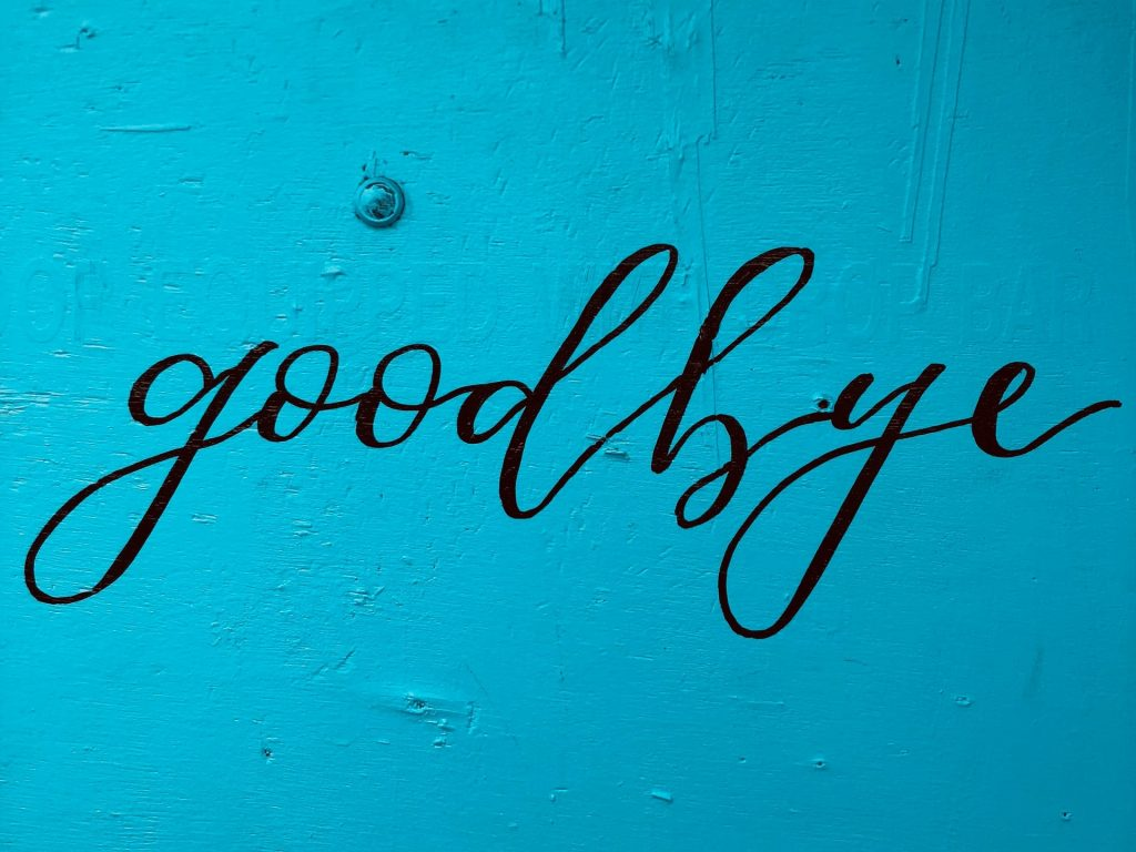 A goodbye sign written on a wall