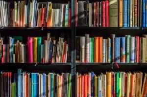 A bookshelf in a  library.