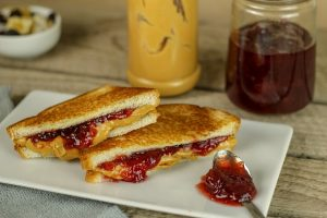 Sandwiches with peanut butter and jam, rarely seen consumed when moving to Denmark