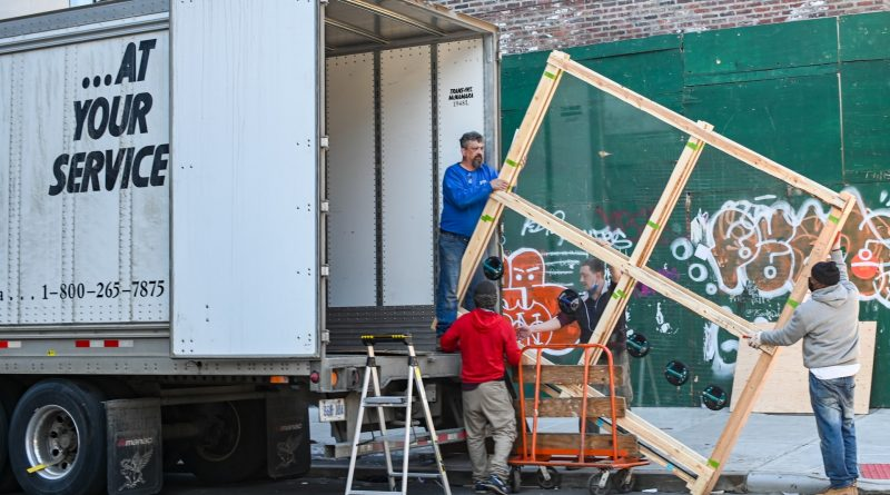 an image of a moving truck, read our step by step guide to preparing your new home for movers