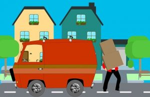 A man loading items into a moving van.