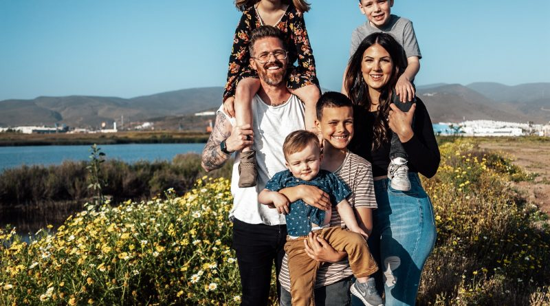 A happy family before moving into a small home with a large family.